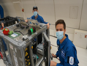 Working on the printer during the flight (Source: ESA)